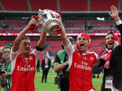 Mesut Ozil has won multiple FA Cups during his time at Arsenal (Nick Potts/PA)