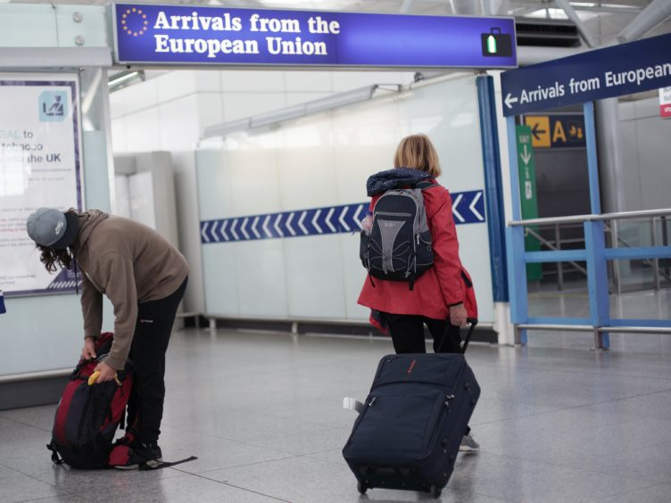 The UK Border Force will check arrivals for test results (Yui Mok/PA)