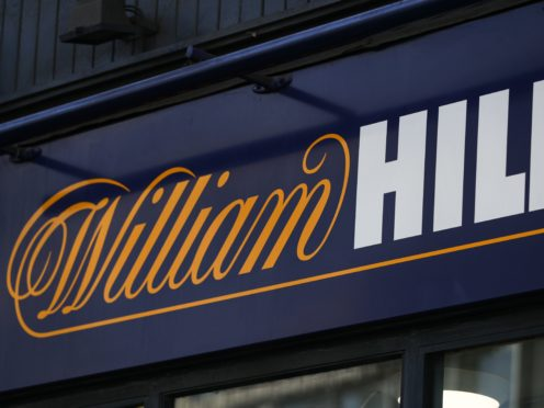 """Gambling firm William Hill has revealed its betting shop business is set to slump to an annual loss of around £30 million while group sales fell 16% after a """"year like no other""""."""