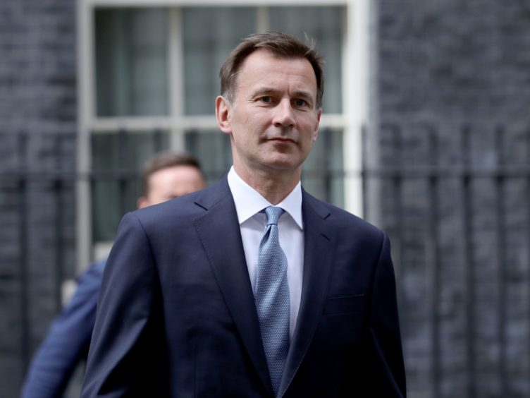 Jeremy Hunt said the UK must become more effective at getting people to isolate (Aaron Chown/PA)