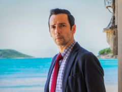 Ralf Little in Death In Paradise (Philip Volkers/BBC/PA)