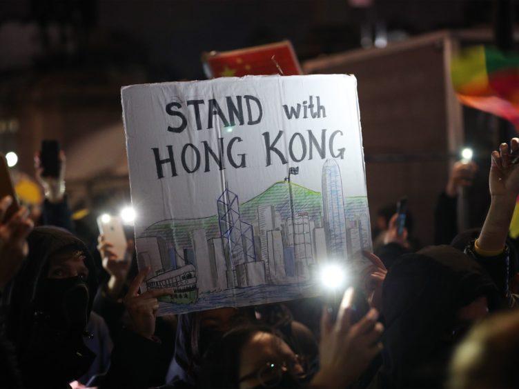 Hong Kong pro-democracy protesters taking part in a Hong Kong solidarity rally in Trafalgar Square, London (Yui Mok/PA)