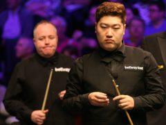 Yan Bingtao, right, will meet John Higgins, left, in the 2021 Masters final (Nigel French/PA)