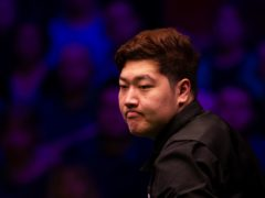 Yan Bingtao fought back from 4-2 to knock out the defending champion (Zac Goodwin/PA)
