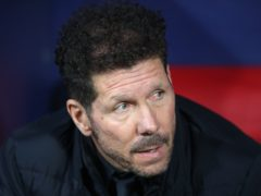 Diego Simeone's Atletico Madrid moved seven points clear with victory over Valencia (Nick Potts/PA)