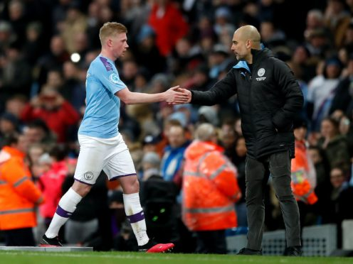Manchester City manager Pep Guardiola is confident Kevin De Bruyne will be at the club for the long term (Martin Rickett/PA)