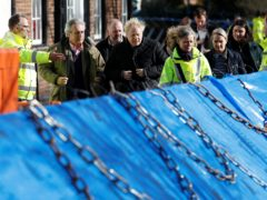 Prime Minister Boris Johnson surveys flood defences in Bewdley (PA)