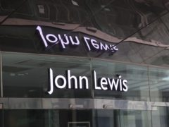 John Lewis Partnership is pushing ahead with plans to axe around 1,500 jobs in a bid to slash costs (Mike Egerton/PA)