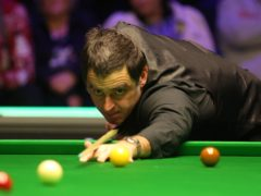 Ronnie O'Sullivan will meet John Higgins in the quarter-final of the Masters after beating Ding Junhui 6-5 (Nigel French/PA)