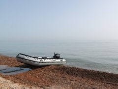 An inflatable boat at Kingsdown beach, near Dover, Kent, where it was abandoned by people thought to be migrants who had used it to cross the English Channel.