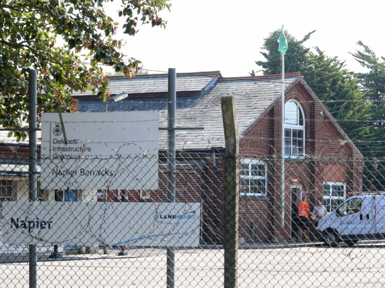 An asylum seeker has said conditions at Napier Barracks near Folkestone in Kent are 'unbearable' (Gareth Fuller/PA)