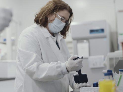 A scientist working on the Moderna vaccine (Moderna/PA)