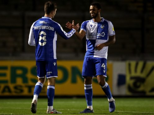 Josh Grant (right) is fit to feature for Bristol Rovers against Sheffield United (David Davies/PA).