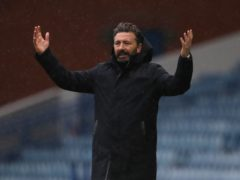 Aberdeen manager Derek McInnes is waiting for news on his three injured players (PA).