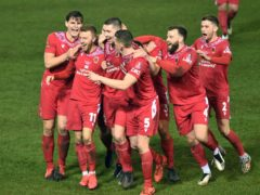 Jamie Vermiglio's Chorley celebrate their equaliser at Peterborough in the second round (Joe Giddens/PA)