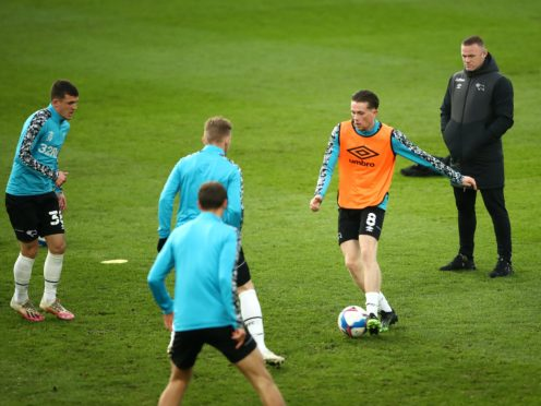 Derby County interim manager Wayne Rooney (right) watches over pre-match training before the Sky Bet Championship match at Pride Park, Derby.