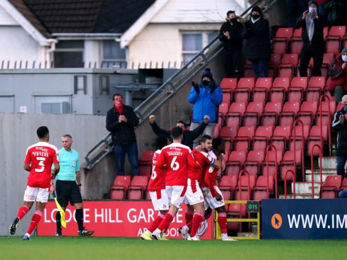 Diallang Jaiyesimi's brace earned a much-needed win for Swindon (Tess Derry/PA)