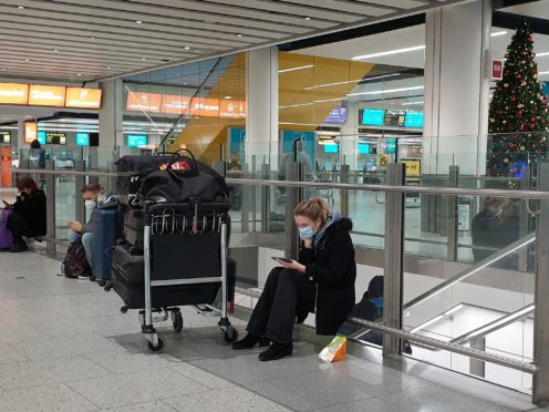 The introduction of new rules requiring travellers to have a negative coronavirus test on arrival in England have been delayed until January 18 (Gareth Fuller/PA).