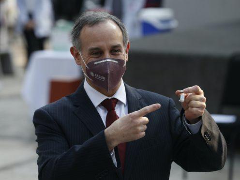 Mexico's coronavirus response leader Hugo Lopez-Gatell points to a vial of the Covid-19 vaccine (Eduardo Verdugo/AP)