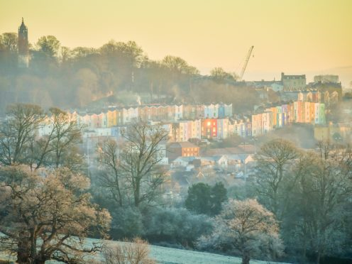 Mist and frost hang around colourful houses in Hotwells, Bristol (Ben Birchall/PA)