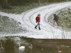 People walking in snow in Lucan, Co Dublin (PA)