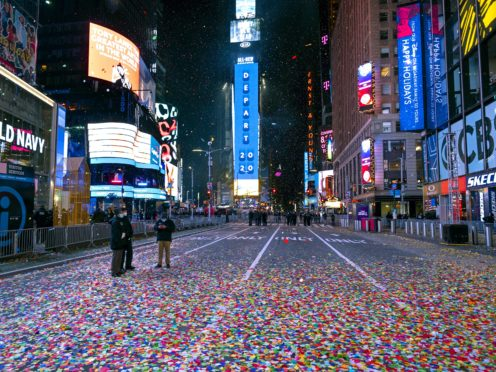Confetti lies on the street after the New Year's Eve ball dropped in a nearly empty Times Square in New York early on January 1 2021 (Craig Ruttle/AP)