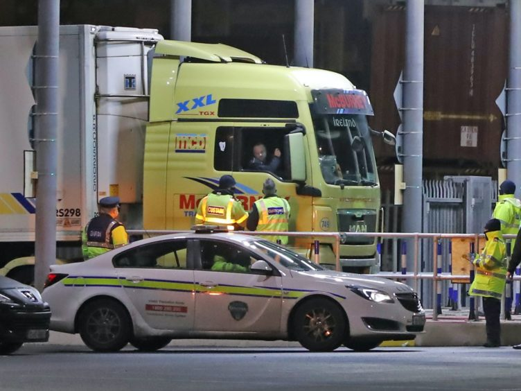 The first truck to arrive in Ireland from Wales under new post-Brexit arrangements is checked at a customs post at Dublin Port (Niall Carson/PA)