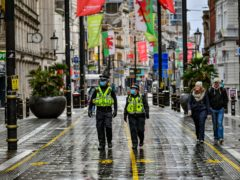 Police patrol a shopping area (PA)