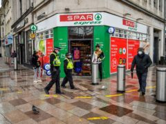 Police patrol the central shopping areas of Cardiff (Ben Birchall/PA)