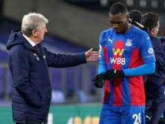 Roy Hodgson, left, seems reluctant to part company with Christian Benteke, right (John Walton/PA)