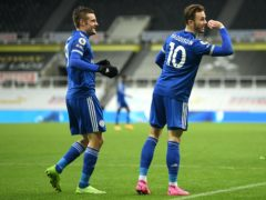 Leicester's James Maddison (right) celebrates his goal at Newcastle with provider Jamie Vardy (Michael Regan/PA)