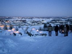 People light candles near the landslide area in the village of Ask in Gjerdrum, Norway (Cornelius Poppe/AP)