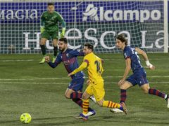 Lionel Messi (centre) set up Frenkie De Jong's goal in Barcelona's win at Huesca (Alvaro Barrientos/AP).
