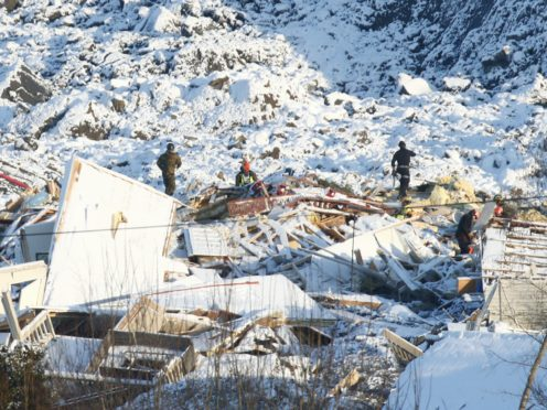 Rescue workers at the site of the landslide in Ask (Terje Pedersen/NTB/AP)