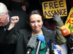 Wikileaks founder Julian Assange's partner, Stella Moris, raises her fist as she speaks to the media (Yui Mok/PA)