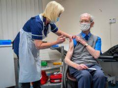 Ralph Evans, 88, receives the Oxford University/AstraZeneca COVID-19 vaccine at Pontcae Medical Practice in Merthyr Tydfil (Ben Birchall/PA)