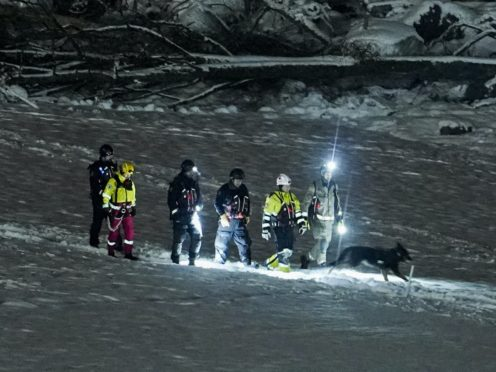 """Rescue workers continue their efforts on the site of a landslide in Gjerdrum, Norway, Monday, Jan. 4, 2021. Norwegian officials are insisting that there's """"still hope"""" of finding survivors in air pockets five days after a landslide killed several people as it carried away homes in a village near the capital. (Fredrik Hagen/NTB via AP)"""