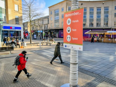 A coronavirus advice poster in the centre of Bristol (Ben Birchall/PA)