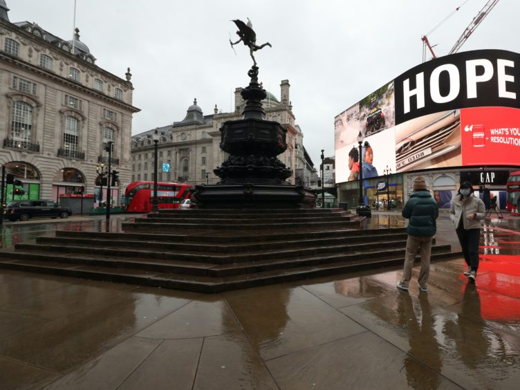 A quiet Piccadilly Circus, London, after Prime Minister Boris Johnson ordered a new national lockdown for England (Yui Mok/PA)
