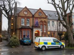 Police outside a care home in Catford (Dominic Lipinski/PA)