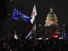 People attend a rally at Freedom Plaza in support of President Donald Trump (Julio Cortez/AP)