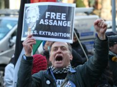 Seven people were detained for breaching Covid-19 regulations as they gathered in London for Julian Assange's latest court hearing (Yui Mok/PA)