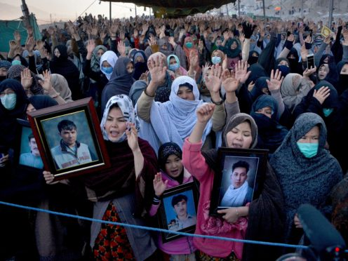 People from the Shiite Hazara community chant slogans during a sit-in to protest against the killing of coal mine workers (Arshad Butt/AP)