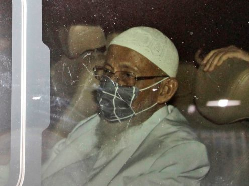 Islamic cleric Abu Bakar Bashir sits inside a van as he leaves upon his release from Gunung Sindur Prison in Bogor, West Java, Indonesia (Aditya Irawan)
