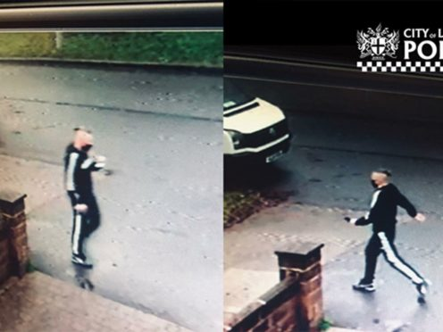 CCTV image of a fraudster claiming to work for the NHS, who jabbed a 92-year-old woman with a fake Covid-19 vaccine (City of London Police/PA)