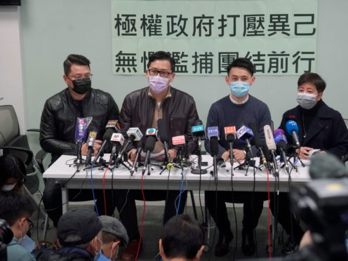 Former Democratic Party legislators Andrew Wan, left, Lam Cheuk-ting, second left, and Helena Wong, right, attend a press conference after being released on bail (KIn Cheung/AP)