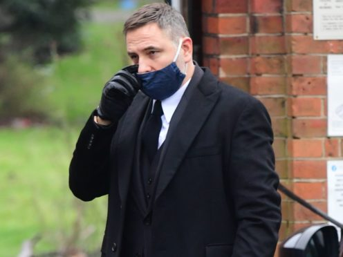 David Walliams arrives at Golders Green Crematorium, north London, for the private funeral service of Dame Barbara Windsor (Ian West/PA)