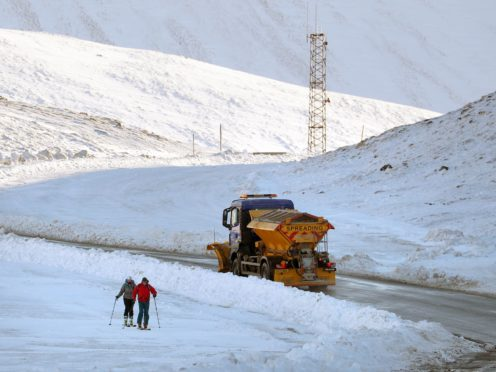 A gritter passes the Glenshee Ski Centre, which is closed due to coronavirus restrictions (Andrew Milligan/PA)