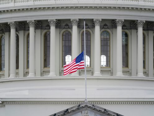 A US flag flies at half-mast in remembrance of US Capitol Police Officer Brian Sicknick (Patrick Semansky/AP)
