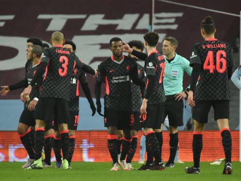 Liverpool's Georginio Wijnaldum (5) celebrates with his team-mates (Rui Vieira/PA)